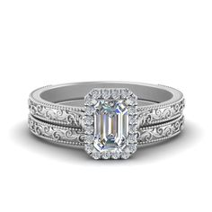 Shop hand engraved emerald cut halo diamond wedding ring set in 14k white gold at Fascinating Diamonds. This diamond engagement ring is designed in Prong setting