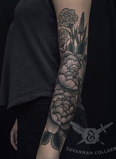 Floral inspired sleeve tattoo. Inked In gray and black, the tattoo is composed of several flowers and leaves making it look like you have your own bouquet right on your hands.