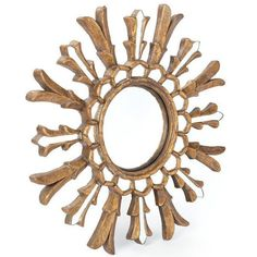 This ornate and beautiful wall mirror is perfect for your entry way or living space. With just the right amount of detail, this mirror with its intricate detailing adds character and excitement to any