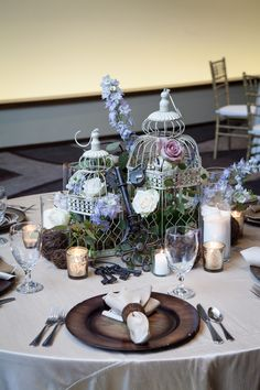 "Birdcages are still ""in"" and can bring a garden/vintage vibe to your tablescape. Even use really eggs if you dare!  