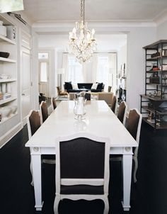 Katie Lee Joel's House   Design by Nate Berkus - love the idea of built in shelves in the dining room (on the left)