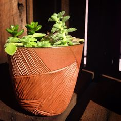 Hand carved terracotta planter by cobaltandkin.com