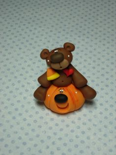 Polymer Clay Bear with Candy Corn  Figurine by ClayBabiesInc
