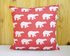 Our polar bears pillow cover in coral red.