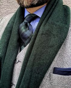 Tartan plaid tie paired with a winter suit and scarf.