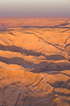 Aerial view from hot air balloon of Hatshepsut's Mortuary Temple at Deir el-Bahri, and the Valley of the Kings at sunrise, Thebes, UNESCO World Heritage Site, Egypt, North Africa, Africa
