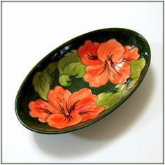 This is the last piece that remains in my personal collection.  This beautiful bowl features Walter Moorcroft's Hibiscus design in the traditional coral color on a textured olive green ground.  The beautiful Hibiscus pattern was designed by Walter Moorcroft.
