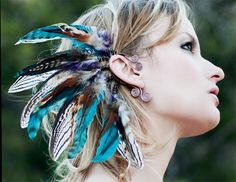 sequoia nights... tribal feather ear cuff. $45.00, via Etsy. This is very pretty and unique. Not quite sure if I could pull it off though.