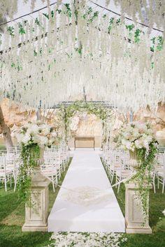 Elegant Greek wedding ceremony: Reception Venue: Island Art & Taste - http://www.stylemepretty.com/portfolio/island-art-taste Ceremony Venue: Vouliagmeni Lake - http://www.stylemepretty.com/portfolio/vouliagmeni-lake Photography: Anna Roussos - annaroussos.com   Read More on SMP: http://www.stylemepretty.com/2016/11/07/this-greek-wedding-is-total-floral-goals/
