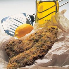 Fish fried plaice fillets with a herb and polenta crust