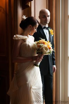 Bridal bouquet by Tulipina  gown by Vera Wang