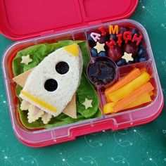space-inspired healthy lunch for kids Infuse some creativity into your children's lunches with these 12 fun ideas. We've rounded up some options that both you and your kids will love. For more recipes and entertaining tips, head to Domino. Bento Box Lunch For Kids, Bento Kids, Kids Lunch For School, Healthy Lunches For Kids, Toddler Lunches, Lunch Snacks, Kids Meals, Lunch Ideas, School School