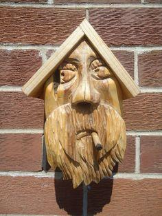 Hand carved cedar wood birdhouse, complete with a cigar bird perch