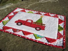 Little Red |Truck : The prairie points needed a little something to set them off, so the mug rug has grown! A plain white, stipple quilted background makes a nice offset, I think!