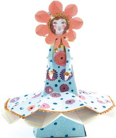 Pretty maiden paper toy to embellish with brightly-coloured glittter and construct, suitable from 7 years
