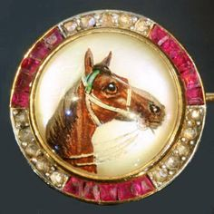 Victorian diamond and ruby horse head brooch- I am a sucker for anything with horses.