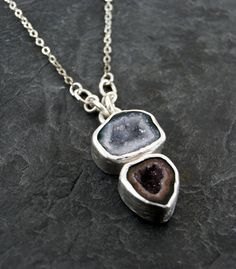 Pendant | Anatomi Designs.  Sterling silver and two druzy agate geodes.
