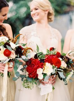 Root Floral Designs combined rich-red, dark-purple, and ivory blooms for this December bride's bouquet.