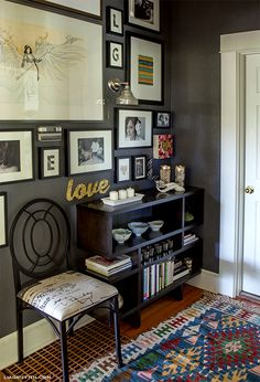 Gallery Wall - love the sentimental objects and dramatic wall color in this photo gallery, which includes both pictures, artwork and accessories. From the home of Lia Griffith and the blog of @Eclectically Vintage. #photogallery #walldecor