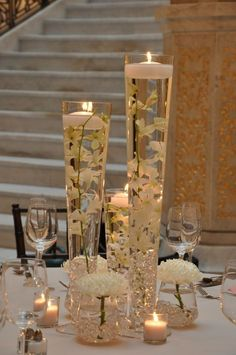 simple all white wedding centerpiece. / http://www.deerpearlflowers.com/floating-wedding-centerpieces/2/