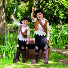 Shop for Travis Designs Pirate Pete Costume at Totally Fancy. This impressive Pirate outfit includes shirt with mock waistcoat and a rustic shoulder sash the waist has a striped sash too. The trousers are fitted with mock over boots and the tri corner hat  cutlass completes the look.
