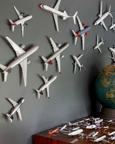 dark grey as a wall color. Makes everything pop, like these mounted toy airplanes + globe.Loving dark grey as a wall color. Makes everything pop, like these mounted toy airplanes + globe. Aviation Decor, Airplane Decor, Displaying Collections, Kid Spaces, Kids Bedroom, Boys Airplane Bedroom, Baby Bedroom, Bedroom Ideas, Bedroom Toys