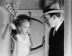 """Davis and co-star Pat O'Brien in 1933's """"Bureau of Missing Persons."""" In 1936, Warner Bros. re-issued the movie giving Davis top billing. She was now a major star."""