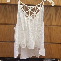 White LF top Its been worn twice but in great condition no stains or flaws it needs to be steamed or ironed so it doesnt stay wrinkled and is shorter in the front send an OFFER LF Tops