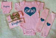 That girls 1st Birthday outfit you've been searching for is right here! Every little diva turning one year old deserves to celebrate in style & this pink & blue glitter heart ONE bodysuit personalized with her name on the rump, custom sequin bow headband, & matching heart patchwork leg warmers is your one stop shop to baby birthday bliss! We can do this design for your little girls half Birthday,  2nd, 3rd, 4th, & 5th Birthday as well!