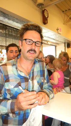 David Arquette came to town to make Scream 3 and he was selling t-shirts at a store named Rear Ends so we went to purchase one and meet him. Scream 3, David Arquette, Make Me Smile, Michigan, Meet, Couple Photos, Store, How To Make, Shirts
