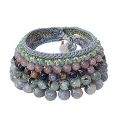 """NOVICA Multi-Gemstone Labradorite Crocheted Wristband Bracelet, 7"""", 'Bangkok Orchid'. An original NOVICA fair trade product in association with National Geographic. Includes an official NOVICA Story Card certifying quality & authenticity. NOVICA works with Chuleekorn to craft this item. Includes an original NOVICA jewelry pouch to keep for yourself or give as a gift. A keepsake treasure designed to be loved for years to come."""