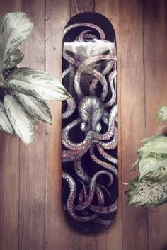 """Normally I'm against dark and muddy coloring but the way it's used by this deck to create a horrific """"lurker from below"""" image that just crawls off the deck. A zombie octopus that disturbs you but captivates your full attention. Very well done deck."""
