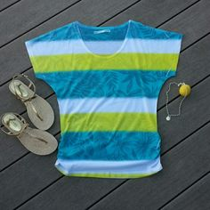 """White, yellow and aqua tropical print striped top Tropical leaf print, short sleeves, ruching at the bottom of each side, scoop neck. 100% polyester.   Bust laying flat 18 1/2"""" Length 24 1/2""""  No trades.  Save even more with a bundle discount! Tops"""