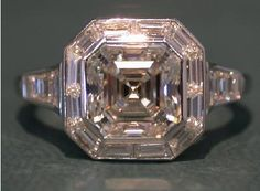 Asscher cut diamond halo engagement ring with tapered baguette diamond halo