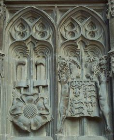 Stone carvings on Prince Arthur's Chantry. The rose of York with ostrich feathers; Henry VII coat of arms.