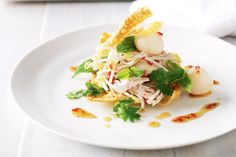Chilli, coriander and mint add flecks of colour to this zingy Asian chicken salad masterpiece.