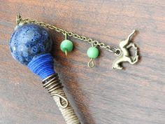 This clip is hand designed, with a beautiful blue bead, hemp-wrapped with a wire twist, an antique brass horse charm, and glass beads.  Keep