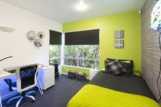 The final reveal! A zingy lime green wall teamed with cool exposed brick wallpaper, motorised blinds and charcoal carpet for this teenage boys bedroom. Decorating products are available in New Zealand through Guthrie Bowron stores.