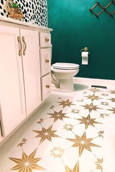 She hated her plain and boring bathroom so she painted the cabinet, walls and tile! See this creative before and after bathroom update. Check out this tutorial how to paint bathroom floor tiles. Painted Bathroom Floors, Bathroom Floor Tiles, Painted Floors, Painted Floor Tiles, Painting Ceramic Tiles, Ceramic Floor Tiles, Star Stencil, Stencils, Small Space Bathroom
