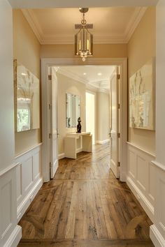 Hallway with great wood floors, molding and cream walls, very pretty.