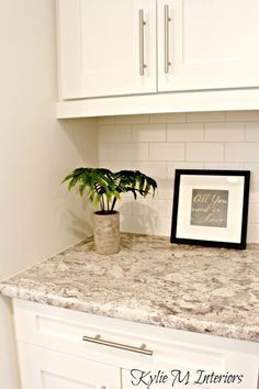 Typhoon Bordeaux laminate countertop, budget friendly kitchen update idea with a subway tile backspash and white cabinets. Oyster White Sherwin Williams on walls