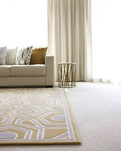 Elegant and light filled | This custom shaped and coloured MANHATTAN by @gregnatale is a warm and welcome addition to this impeccable living space by @sommercookinteriors. The soft allusions to gold and silver work perfectly with the accent table and scatter cushions. Enquire today about customising one of our many designs to suit your home - www.designerrugs.com.au Reposted Via @designerrugs