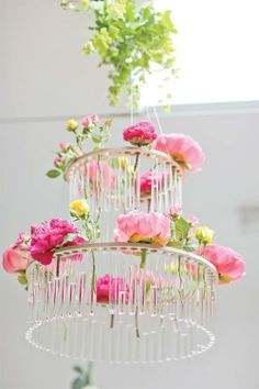 flower chandelier takes my biggest complaint about hanging flowers - the pipette for water is always too visible - and makes it a part of the decor! How genius!Visit theboutiquewedding.tumblr.com