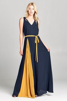 Contrast pleated panel two-tone maxi dress in washed crepe fabric. This sleeveless maxi dress features a classic V-neckline, contrast pleated skirt panel, and a removable waist sash. Concealed hook and eye zipper closure and lining. Color: Blue & Mustard Rayon Made in USA True To Size