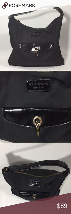 Kate Spade Black Shoulder Bag Patent Strap Detail Black Kate Spade shoulder bag. Black with white polka dots line the body as well as the front flap of the bag. Nice gold hardware detail. Patent strap and pocket flap detail. Measures 13x3x15 kate spade Bags Shoulder Bags