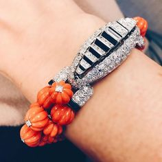 Cartier Art Deco carved coral, diamond and onyx bracelet. Offered at Christie's New York
