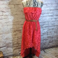 SZ LG TRIXXI STRAPLESS LACE HI/LO DRESS Beautiful coral dress with a brown woven belt. Lined to the knee and Hi/Lo outer lace bodice. JUNIOR SIZING Trixxi Dresses High Low
