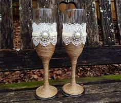 *** My processing time for this set is 3 weeks out. If you need it sooner, please send me a message for a rush order fee option.  Rustic, vintage and chic! Add these toasting glasses and the cake serving set to your wedding list. If you are having a rustic, vintage chic wedding, this design is perfect. The lace is off white / ivory and is very detailed and has a vintage look. Its absolutely stunning. I have an ivory silk ribbon wrapped around the center. In the front is a beautiful pearl...