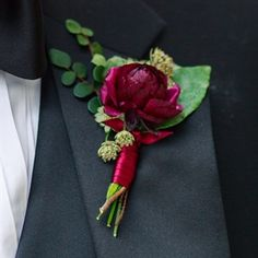 The boutonnieres will be burgundy ranunculus, dark pink astrantia, and seeded eucalyptus wrapped in emerald green velvet ribbon and the stems showing.