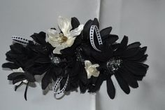 Black daisies with silver centres interspersed with small white magnolias. Accented with black and white ribbon. Perfect for a black and white wedding or to accent a little black dress. Black And White Ribbon, Magnolias, Hair Comb, Daisies, Special Occasion, Trending Outfits, Unique Jewelry, Handmade Gifts, Silver